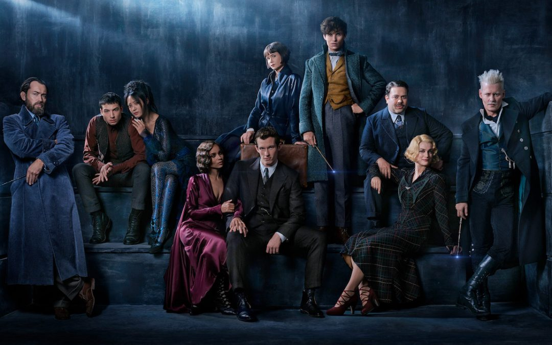 "Warner Bros. releases  new photos of ""Fantastic Beasts: The Crimes of Grindelwald"" featuring Jude Law as a young Albus Dumbledore and Johnny Depp as a young Gellert Grindelwald."